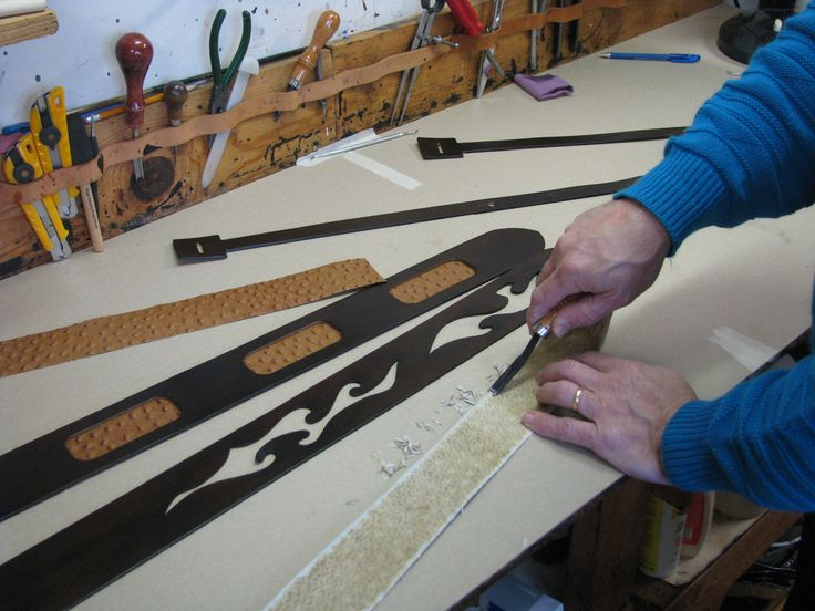 Skiving leather inlay for custom guitar straps with leather craft tool.