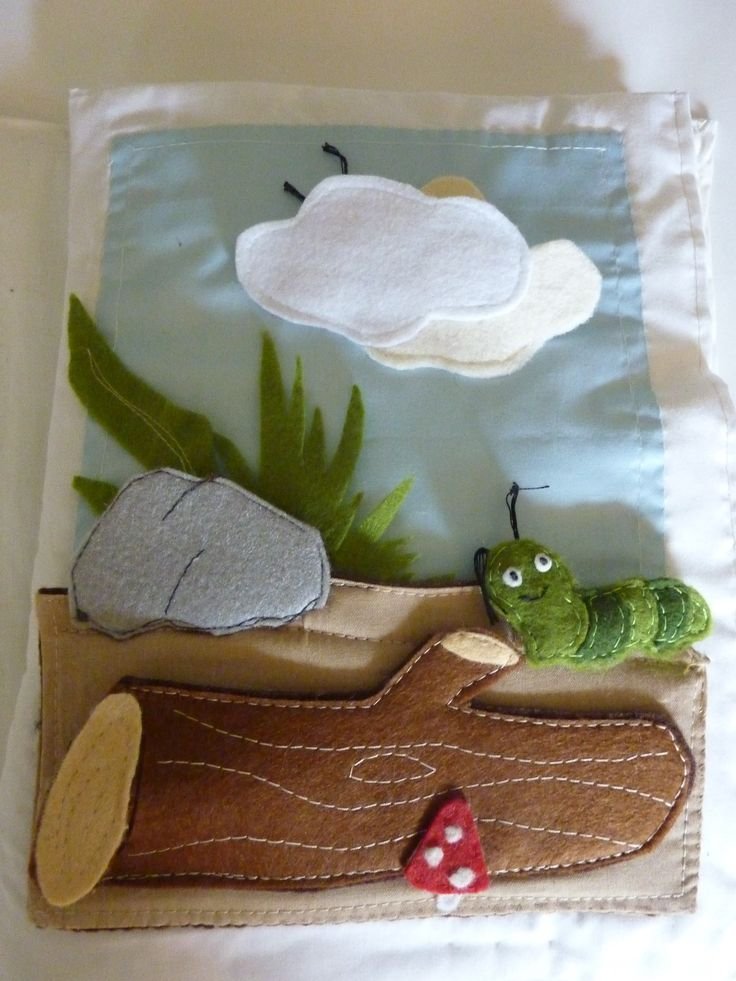 quiet book page, caterpillar and hidden animal behind the tree trunk.