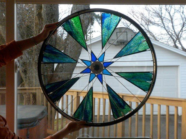 Bicycle wheel embellished with stained glass by Lynn Henderson Bolduc
