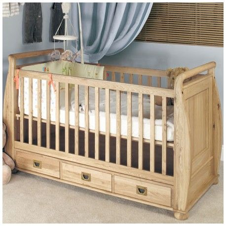 This Oak Cot Bed with Three Drawers is ideal for the children's bedroom. The childrens furniture has been constructed with solid oak and is nicely finished off with three drawers. This Oak Cot Bed with three drawers can be converted into a childs sleigh bed or day bed as the child gets older.  Dimensions are : Height : 70cm Width: 45 cm Depth : 35 cm Finish : Wood Material : Solid Oak PLEASE NOTE: