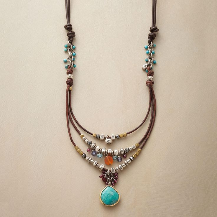 """COMPENDIUM NECKLACE -- Our handcrafted leather, sterling bead and gemstone necklace is a compendium of colorful gems and sterling silver beads, bedecking a leather cord. A handmade exclusive with turquoise, garnets and more. Slide adjusts length from 18"""" to 28""""L. Designed by Nicole Ardis jewelry"""