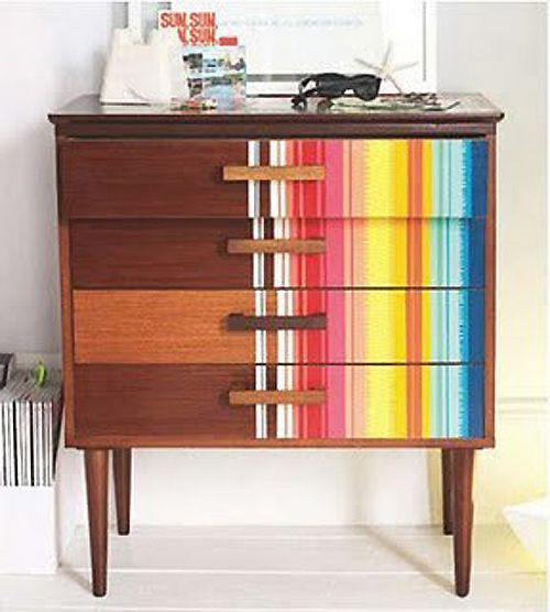 Color furniture with vertical rainbow stripes like this Zoe Murphy chest of drawers. You can try strips of coloured tape for a non permanent option, assuming you aren't like me and have the patience to rip off the tape carefully afterwards.
