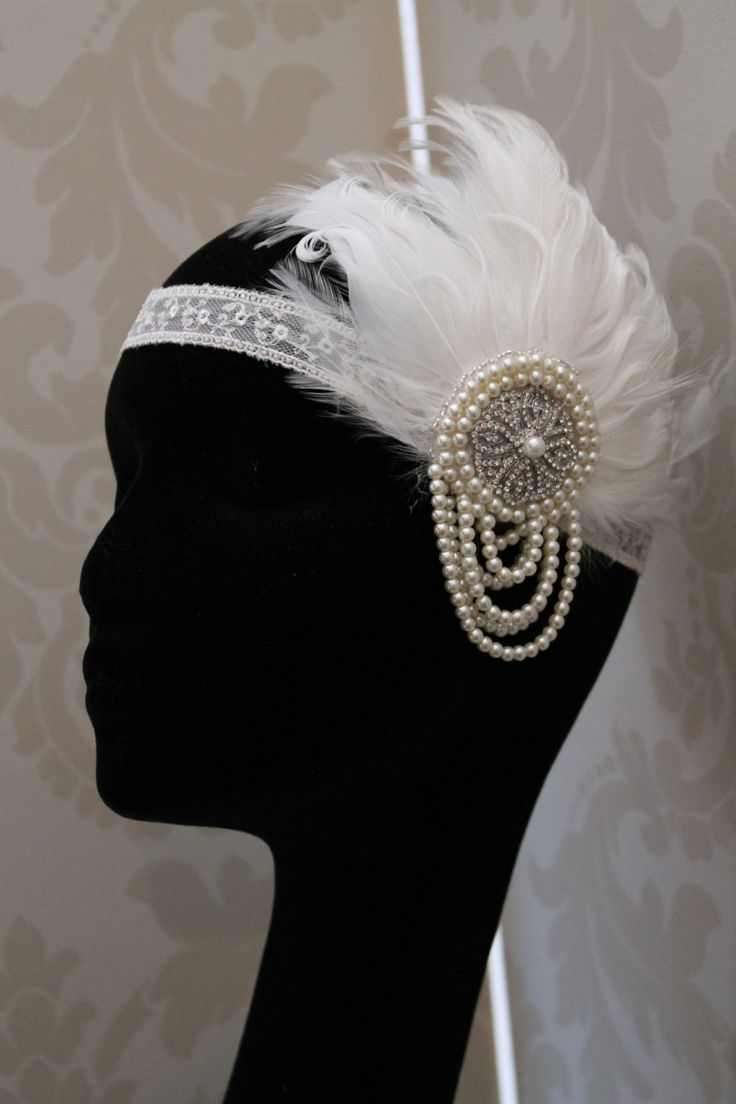 Handmade handbeaded bridal feather headdress wedding headpiece vintage style 1920s flapper style ivory Bridal headdress. £69.00, via Etsy.