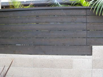 Love this stain. Cedar with BEHR's semi transparent stain in 'cordovan brown'. debora carl landscape design