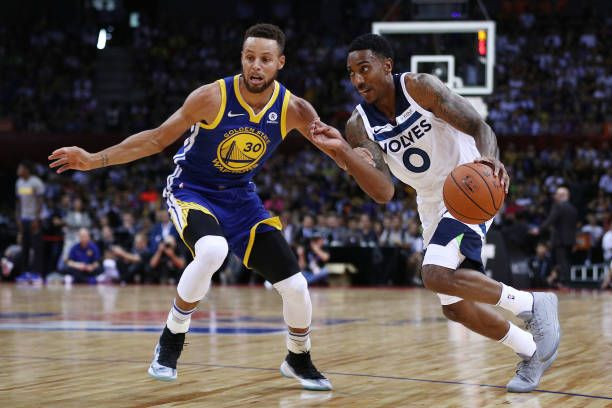 Jeff Teague of the Minnesota Timberwolves in action against Stephen Curry of the Golden State Warriors during the game between the Minnesota...