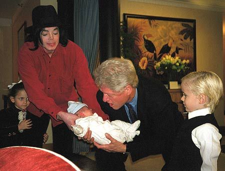 Michael Jackson letting President Clinton hold Blanket :)  I think President Clinton got to hold each of his kids as a baby :)