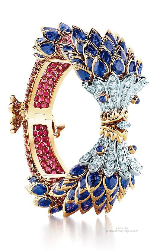 Fish Bracelet by Jean Schlumberger | Tiffany & Co | Sapphires, red spinels and diamonds set in 18 carat gold. ~~~Also see http://www.tiffany.co.uk/WorldOfTiffany/TiffanyStory/Design/JeanSchlumberger.aspx and http://www.luxurydaily.com/tiffany-eyes-aspirational-loyalists-in-facebook-exclusive-campaign/ ~~~