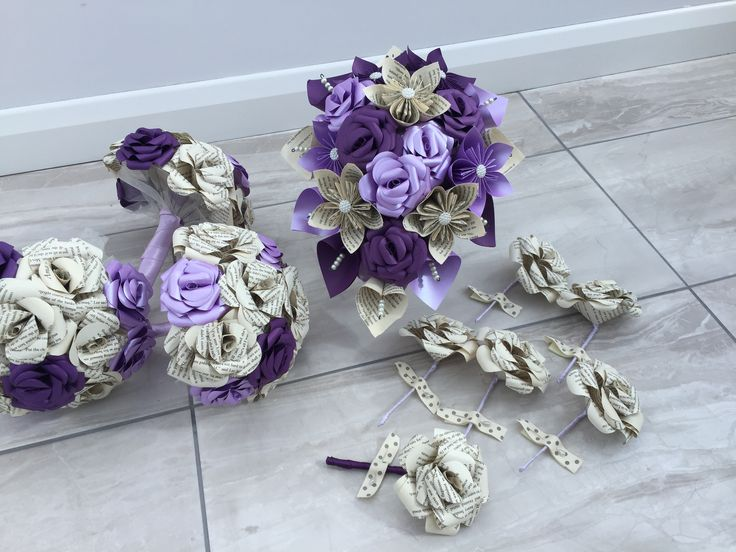 Custom made wedding flower package in book page and purple  Www.facebook.com/DianaSianCrafts Www.etsy.com/uk/shop/DianaSianCrafts