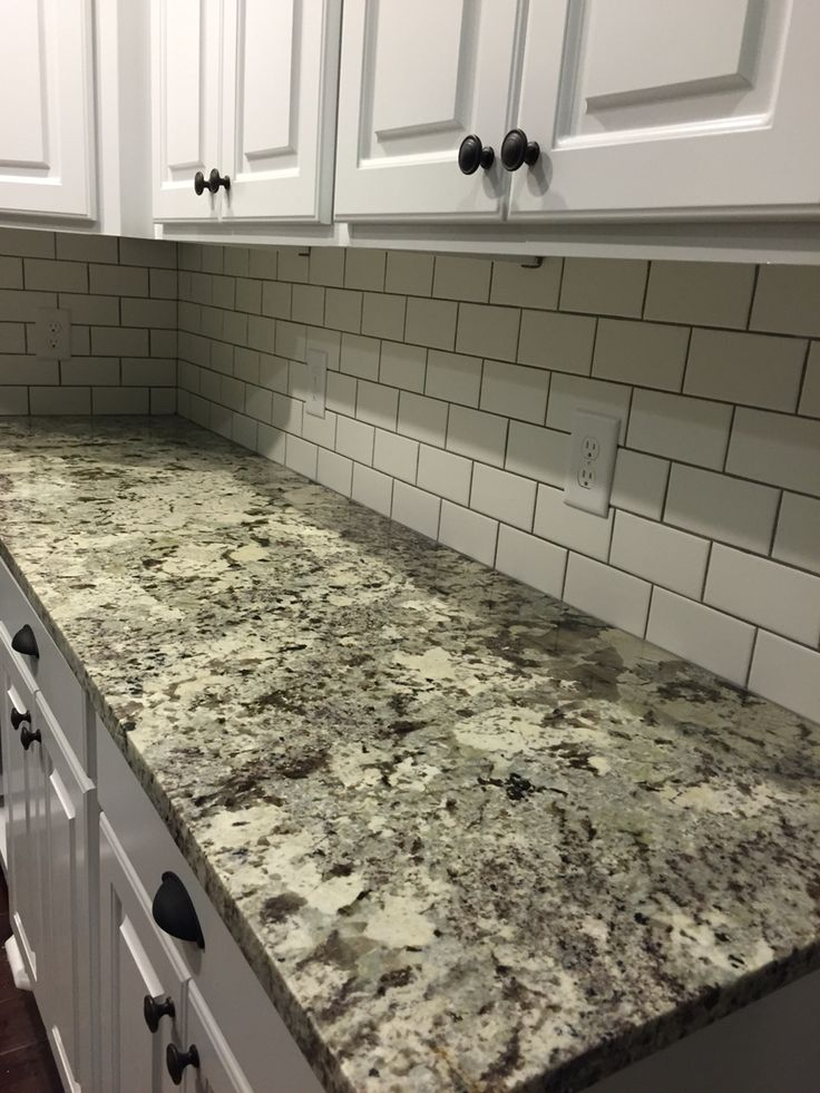 White subway tile & Alaskan white granite