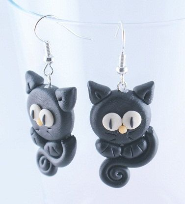 Hey, I found this really awesome Etsy listing at http://www.etsy.com/listing/77574123/black-kitty-cats-polymer-clay-earrings