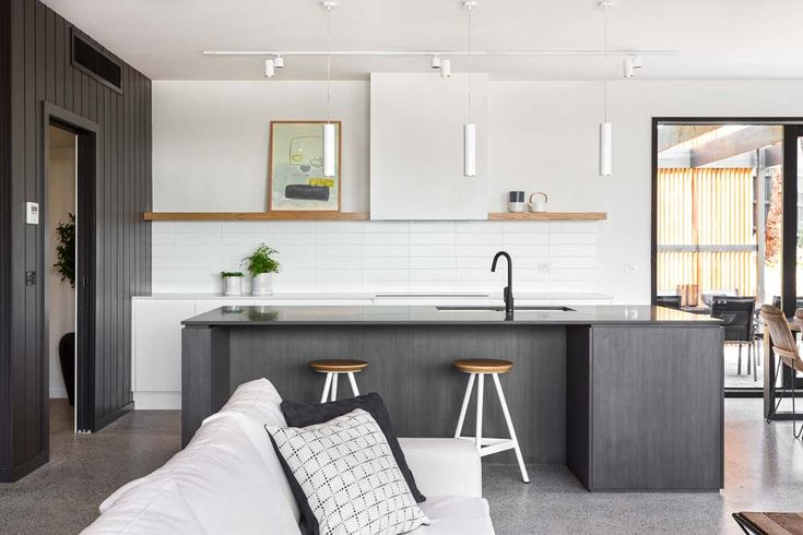 Kitchen - timber shelves; black tapware; panelling; flue boxed in; shadowline to be timber