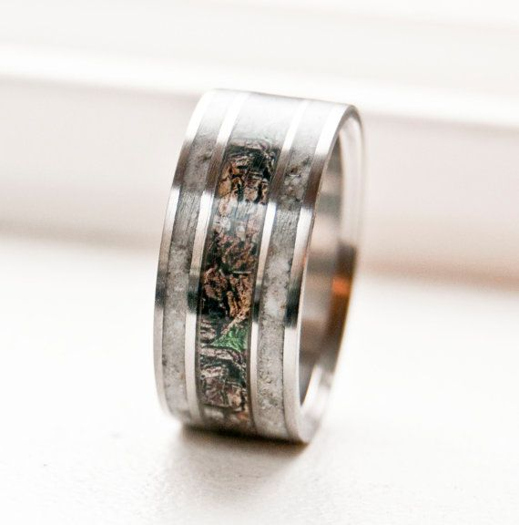 Mens Camo Wedding Ring with Real Antler by StagHeadDesigns on Etsy, $400.00.   THIS IS IT!!!