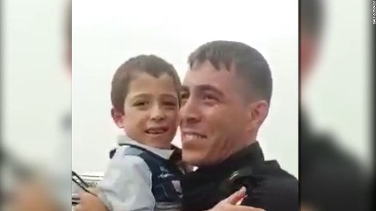 An Iraqi special forces soldier spots his family amid the refugees fleeing Mosul.