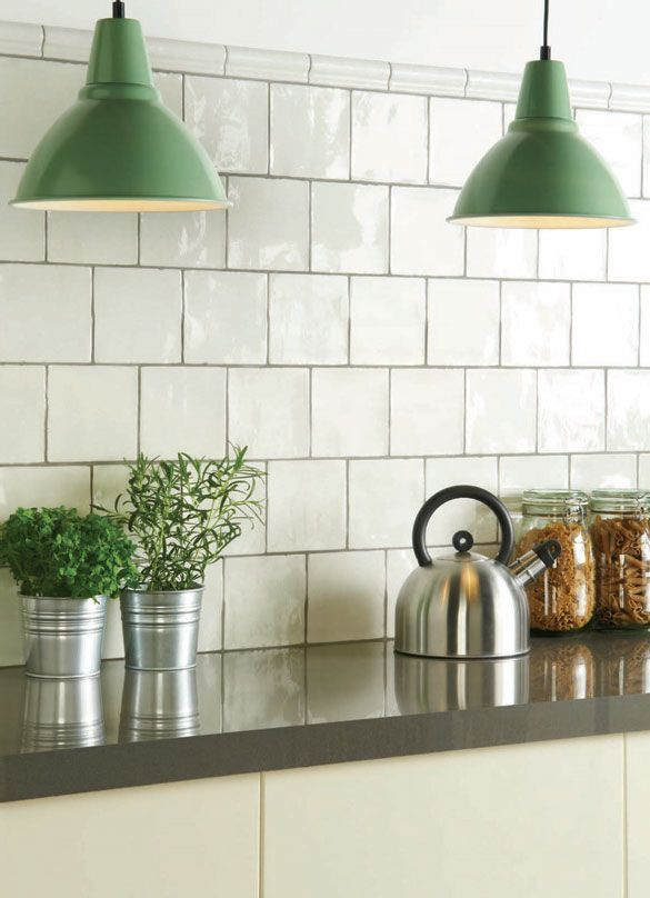 These green pendant lamps add an elegant finishing touch to the kitchen.