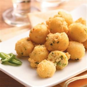 Peppery Hush Puppies Recipe -For our family, a good fish dinner just isn't complete without these zesty hush puppies. You can also serve them alone as a satisfying snack. —Carolyn Griffin, Macon, Georgia