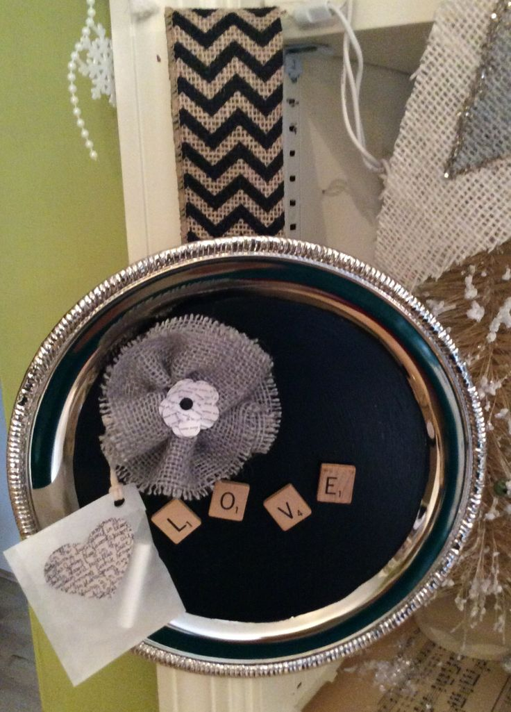 Another Dollar Tree silver tray idea. I used chalkboard paint, magnetic scrabble pieces, a burlap flower, and even a piece of chalk in a glassine bag. Gotta Love Dollar Tree!