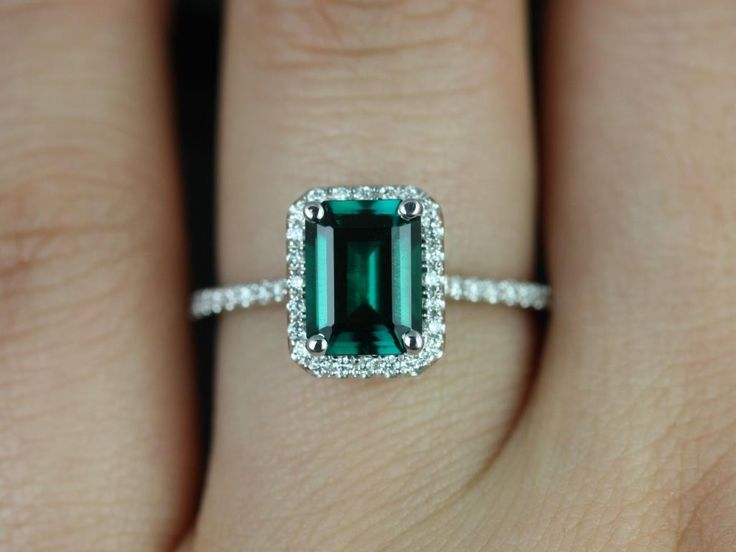 White Gold Rectangle Emerald and Diamond Halo setting. I like the rectangle setting. This stone is a little too deep in color but I like the size of it and the delicate band.