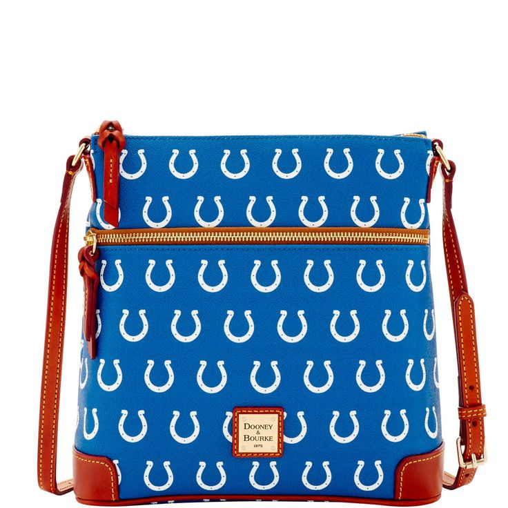 Like denim and t-shirts, or cashmere and pearls, Dooney & Bourke and the NFL are a classic fashion combination. Made of coated canvas with contrasting leather trim, the Crossbody has a slim profile and multiple pockets for organized storage. It's the ideal companion for weekend errands or happy hour with friends