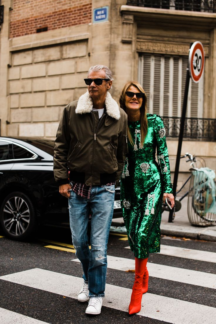 Vogue Editor-at-Large Anna Dello Russo, with partner Angelo Gioia, outside the Valentino show