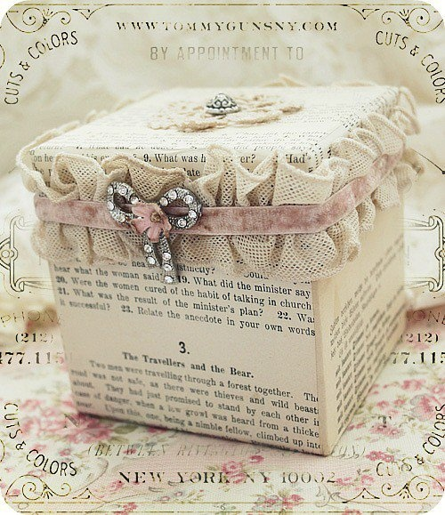 wrap a petite box with an antique book page and add vintage ribbon and button or brooch