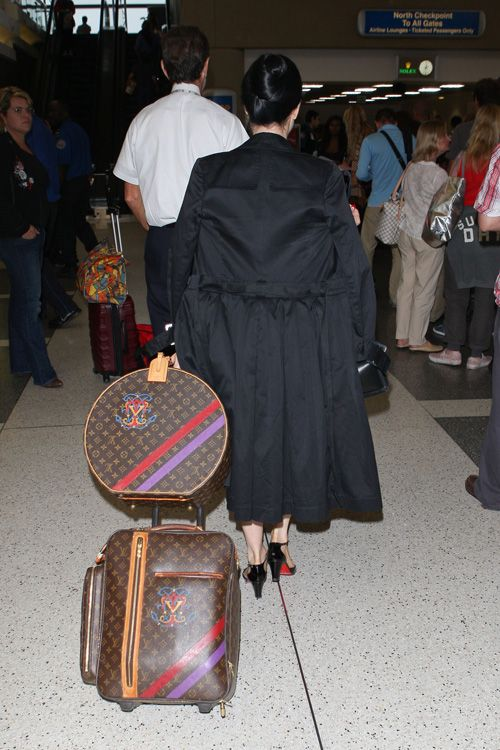 Dita Von Teese's combination of a crest-customized vintage Vuitton hat box and rolling suitcase is about as classy as luggage gets.