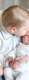 Prince George, who turns two next month,  cuddles up to his younger sibling in this charming set of images captured by the Duchess of Cambridge at Anmer Hall, the royal's country home in Norfolk.
