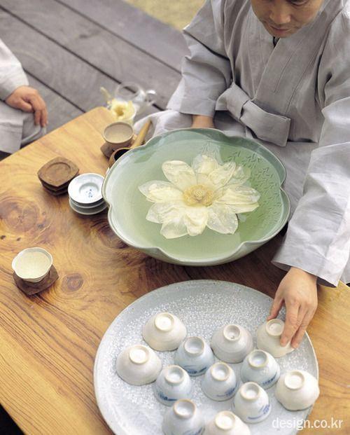 A Buddhist monk preparing white lotus tea at Yeongpyeongsa Temple in South Korea.