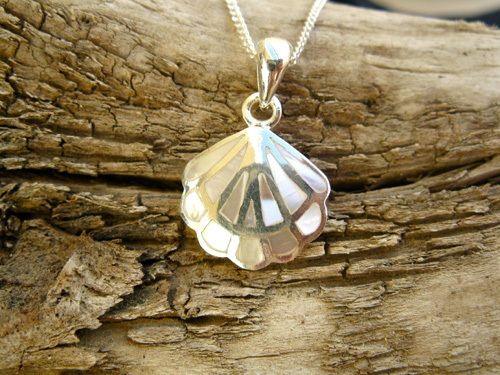 Camino jewelry necklace ~ silver + mother-of-pearl. An opulent and unique gift to promote courage, strength and hope. This beautifully delicate sterling silver and mother-of-pearl scallop shell makes a marvellous gift of faith.