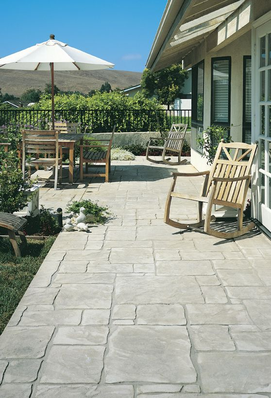 Stamped Concrete patio. Product used: LITHOTEX® Pavecrafters® English Yorkstone pattern, LITHOCHROME® Color Hardener, LITHOCHROME® Antiquing Release. © 2013 L. M. Scofield Company. All rights reserved.