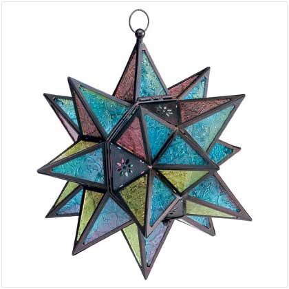 Moroccan-Style Star Lantern.  The many-pointed Moroccan star is the inspiration for this multicolored lantern.   Insert a tealight or votive to set the jewel-tone panels aglow!
