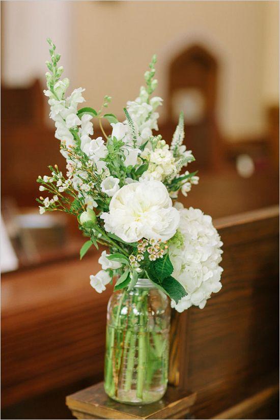 Mason jar floral arrangements to add decor to a traditional church ceremony setting. Floral Design: Ashley Elaine ---> http://www.weddingchicks.com/2014/05/12/are-you-a-camera-shy-bride-or-groom/