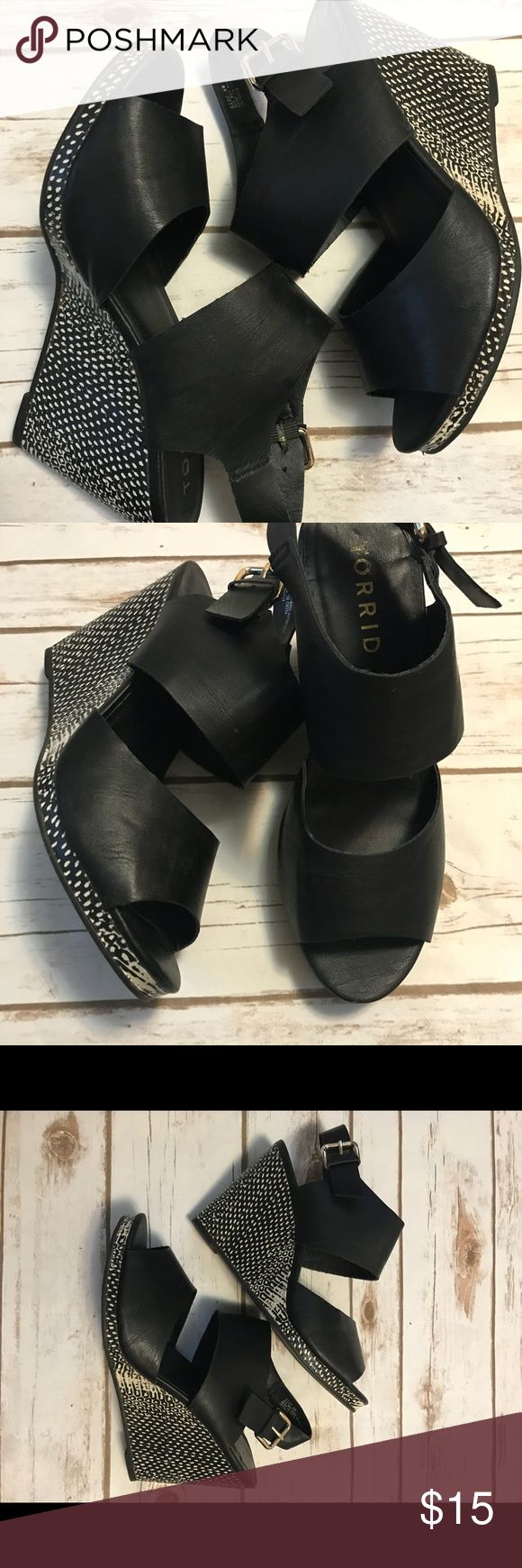 Studded Metallic Wedge Sandals (Wide Width) A snake-like pattern gives this black wedge sandal some real attitude. Wide faux leather straps complete this modern look.  -4inch  -gentle worn torrid Shoes Wedges