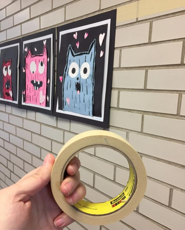Art Teacher Hack: Line brick/cinder block walls with two rows of masking tape, and use hot glue to attach top corners of mounted art to the wall. Stays up as long as you need it to, and pops off easy when it's time to take it down. What a time saver! I can't believe I ever used to use tape loops! #ArtTeacherProblems #ProblemSolved