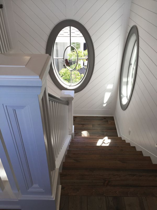 Street of Dreams - Shiplap and Oval Windows in the Staircase