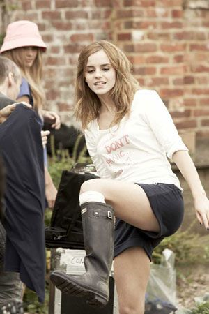 Every festival fashionista's must-have: a pair of funky wellies! Emma Watson rocks these black Hunters.