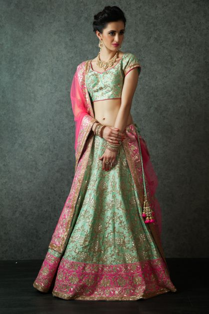 W16-141 - Pure raw silk lehenga and blouse with net dupatta embellished with zari and gota work