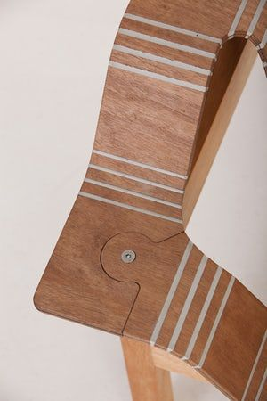 The plywood is scored and the gaps filled with flexible polymer, meaning the wood can be...