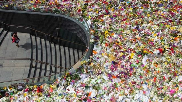 <p>Relatives of Katrina Dawson and Tori Johnson have visited a makeshift memorial in Martin Place, joining thousands continuing to grieve for the two victims of the Sydney siege.</p><p> As authorities face mounting pressure to explain how Man Haron Monis fell off watch lists and had access to a gun, the families have slowly made their way around the memorial and enormous floral tribute.</p><p> Family members of Ms Dawson were visibly upset as they read cards and embraced each other at the…