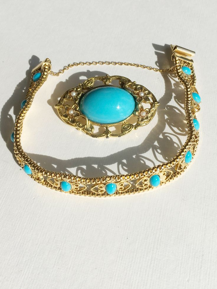 Vintage gold tone evening runway fashion style turquoise color stones bracelet brooch by MariniJewellery on Etsy https://www.etsy.com/ie/listing/549418574/vintage-gold-tone-evening-runway-fashion