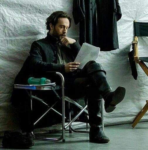 BTS Tom with his script.