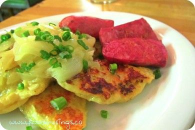 Osborne Village Cafe's Perogies stuffed with maple poached bacon, potato, cheddar and dill and a side of Farmer's Sausage