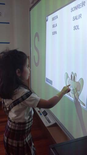 Cutie tips the SMART Board for random words.