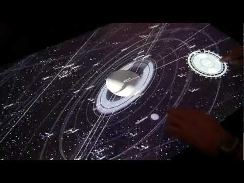 NUIverse - A universe simulator for Microsoft Surface 2.0. Looks awesome.