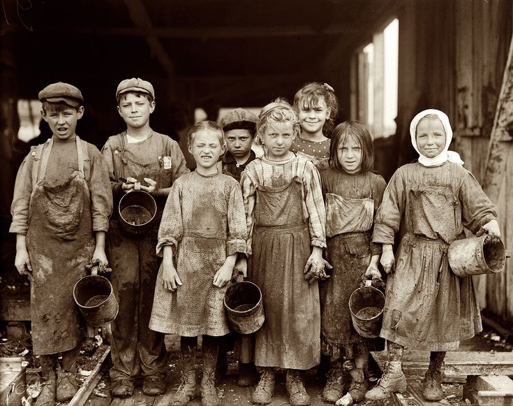 """February 1912. Port Royal, South Carolina. """"Nine [?] of these children from 8 yrs. old up go to school half a day, and shuck oysters for four hours before school and three hours after on school days, and on Saturday from 4 a.m. to early afternoon. Maggioni Canning Co."""" Photo and caption by Lewis Wickes Hine."""