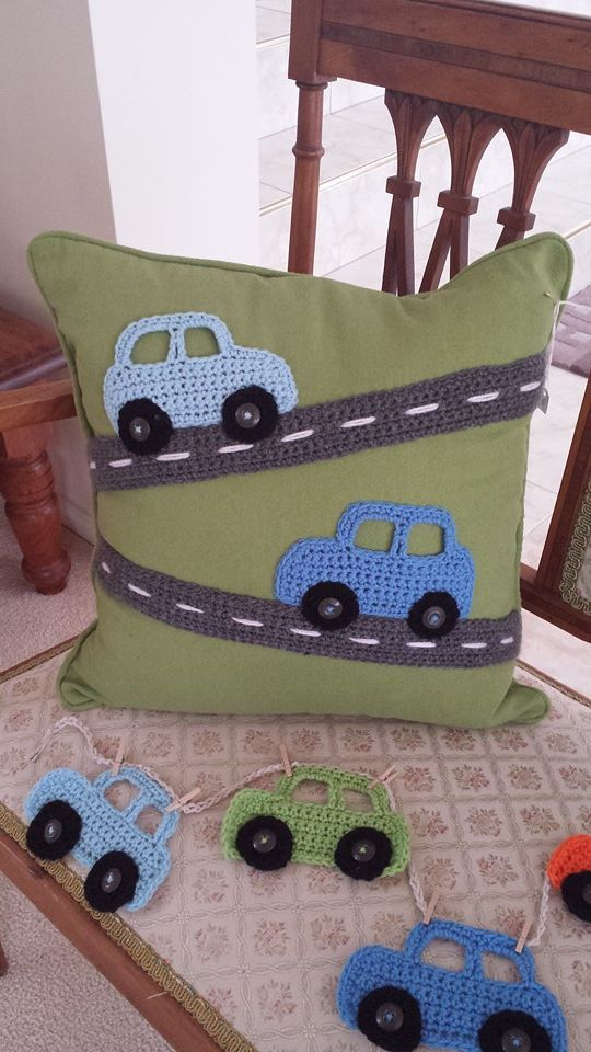 A cushion with my own design crochet cars on a crochet road.