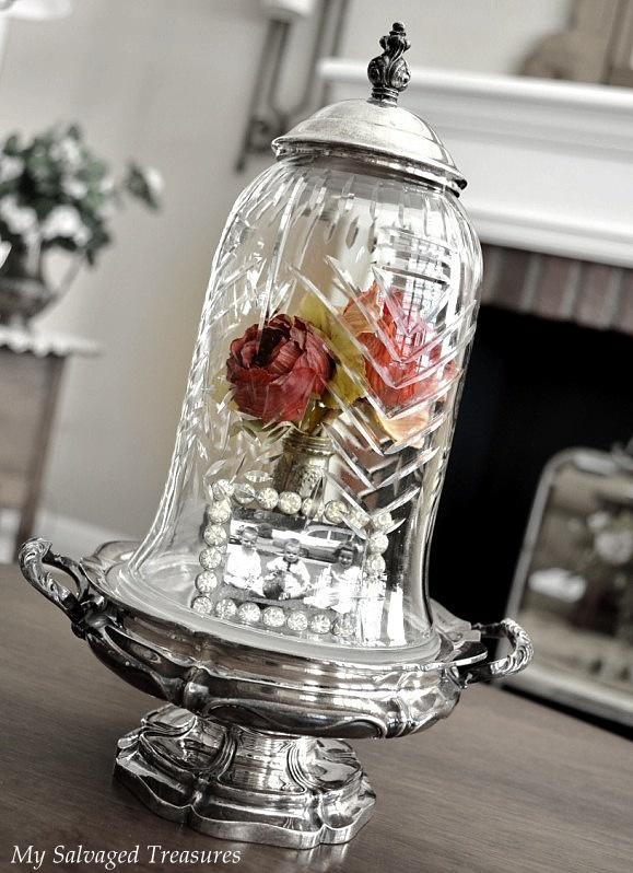 put glass vase between silver set and you have a gorgeous cloche!!