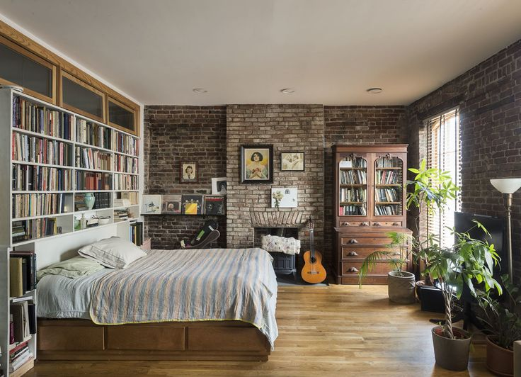 Brick Walls A Fireplace And Bookcases In Long Island City NY Not The Fanciest Bedroom