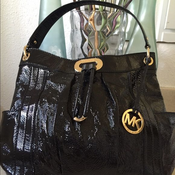 Price Negotiable MK Black Handbag Available!! Authentic Michael Kors black patent handbag. Inside, it has 4 slot compartments, 2 on each side and a change zipper. No stains, no marks, no tears, very clean. In excellent condition! No trades, pls. Price is negotiable! Michael Kors Bags