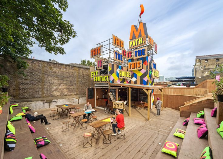 DesignerMorag Myerscoughused the tweets of a poet to create the bold graphics surrounding this temporary cafe in London.