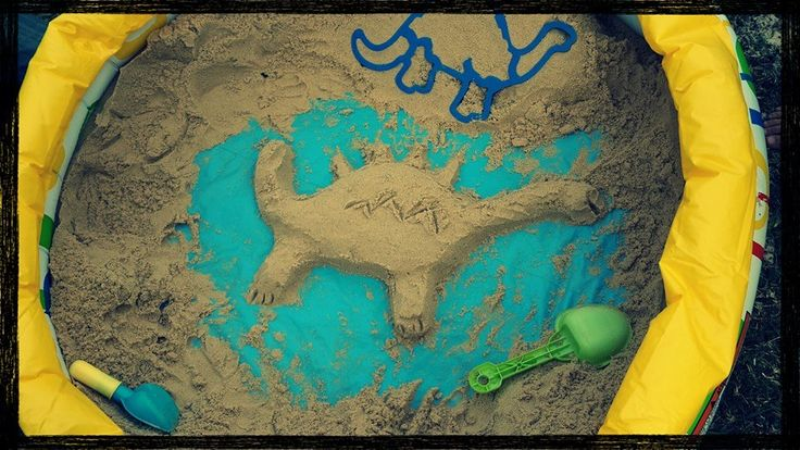 Dinosaur Party - the kids loved looking for hidden little dinosaurs in the sand, once all was found, they became creative. Kids blow up pool filled with play sand and hidden dinosaurs.